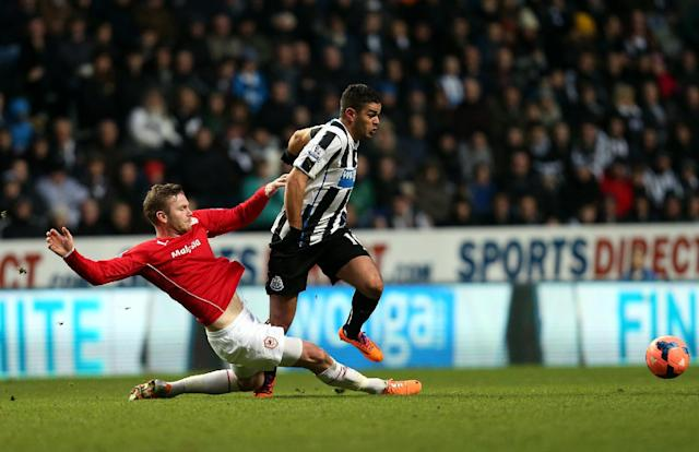 Newcastle United's Hatem Ben Arfa, right, vies for the ball with Cardiff City's Aron Gunnarsson during their English FA Cup third round soccer match at St James' Park, Newcastle, England, Saturday, Jan. 4, 2014. (AP Photo/Scott Heppell)