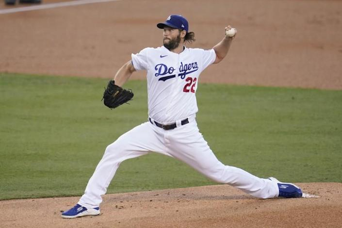 """Left-hander Clayton Kershaw reached 2,500 career strikeouts and the Dodgers picked up another win Thursday night, 5-1 over the Diamondbacks. <span class=""""copyright"""">(Marcio Jose Sanchez / Associated Press)</span>"""