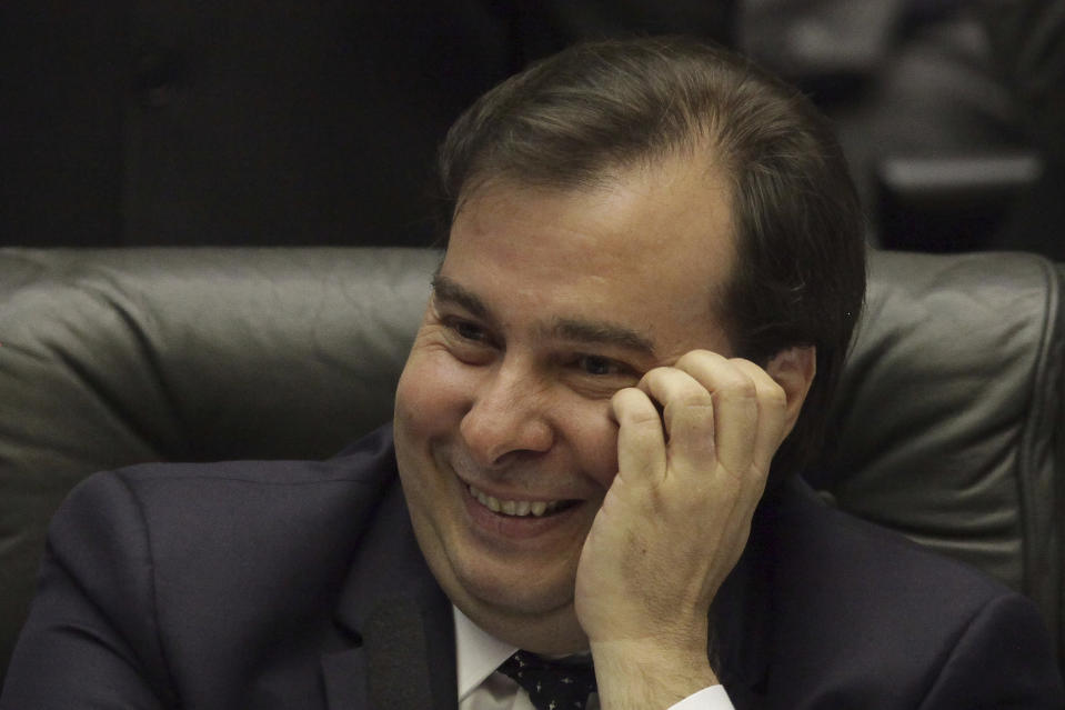 Brazil's Lower House Speaker Rodrigo Maia takes part in a congressional hearing, before a key vote by the lower chamber on whether to suspend President Michel Temer and put him on trial over an alleged bribery scheme to line his pockets, in Brasilia, Brazil, Wednesday, Aug. 2, 2017. Temer appeared to have the upper-hand and is confident he can survive bribery charge vote. (AP Photo/Eraldo Peres)