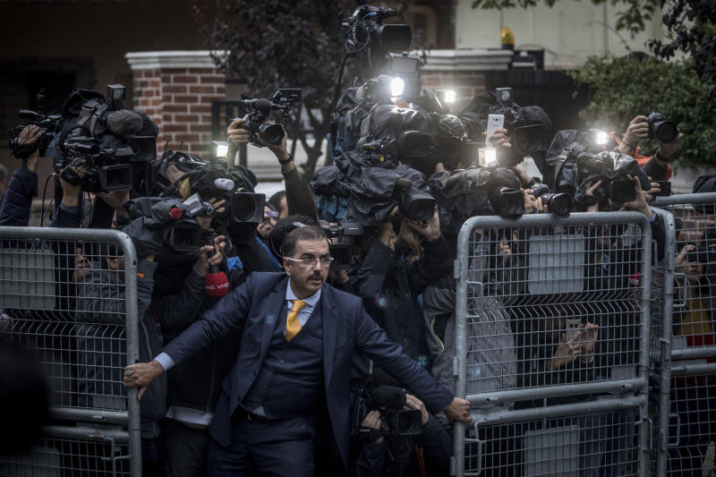 "In this image released by the World Press Photo Foundation Thursday April 11, 2019, titled ""The Disappearance of Jamal Kashoggi"" by Chris McGrath, Getty Images, which was awarded first prize in the General News, Singles, category, shows an unidentified man trying to hold back the press as Saudi investigators arrive at the Saudi Arabian Consulate in Istanbul, Turkey, amid a growing international backlash to the disappearance of journalist Jamal Khashoggi. (Chris McGrath, Getty Images, World Press Photo via AP)"