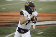 California quarterback Chase Garbers (7) rolls out to throw the ball during the second half of an NCAA college football game against Oregon State in Corvallis, Ore., Saturday, Nov. 21, 2020. Oregon State won 31-27. (AP Photo/Amanda Loman)