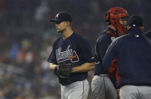 Atlanta Braves starting pitcher Mike Minor is pulled during the seventh inning of an interleague baseball game against the Detroit Tigers in Detroit, Sunday, April 28, 2013. (AP Photo/Carlos Osorio)