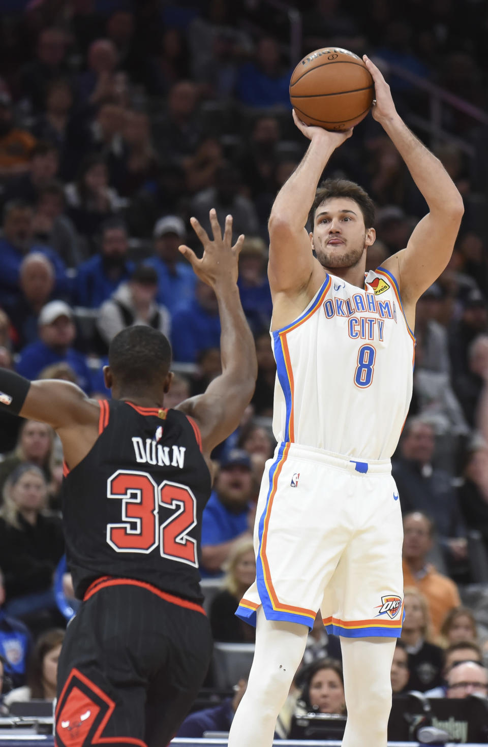 Oklahoma City Thunder forward Danilo Gallinari shoots the ball over Chicago Bulls guard Kris Dunn in the second half of an NBA basketball game, Monday, Dec. 16, 2019, in Oklahoma City. (AP Photo/Kyle Phillips)