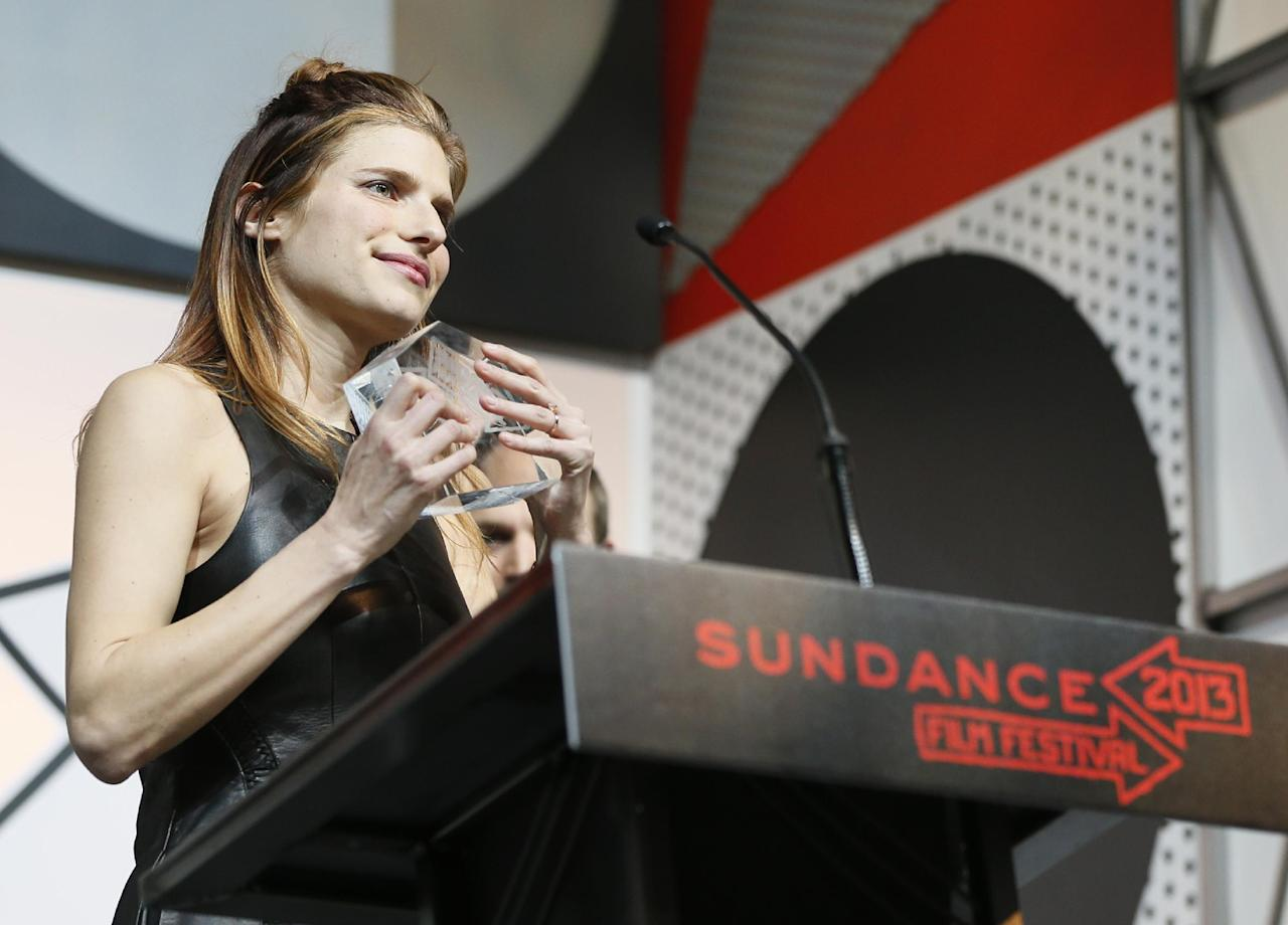 "Director, writer and cast member Lake Bell accepts her U.S. Dramatic Waldo Salt Screenwriting Award for ""In A World..."" during the 2013 Sundance Film Festival Awards Ceremony on Saturday, Jan. 26, 2013 in Park City, Utah. (Photo by Danny Moloshok/Invision/AP)"