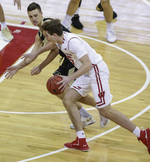 Wisconsin's Nate Reuvers (35) drives against Purdue's Grady Eifert during the first half of an NCAA college basketball game Friday, Jan. 11, 2019, in Madison, Wis. (AP Photo/Andy Manis)