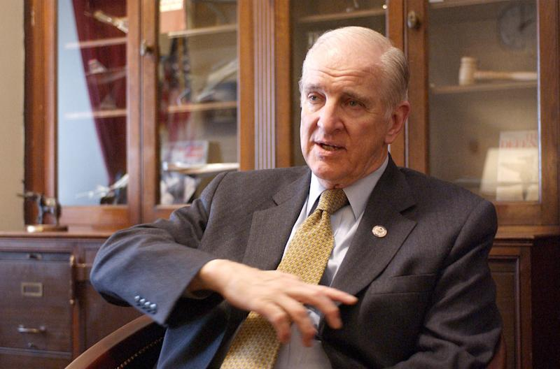 Rep. Sam Johnson, R-Texas, gestures during an interview in his Capitol Hill office Tuesday, Feb. 11, 2003.