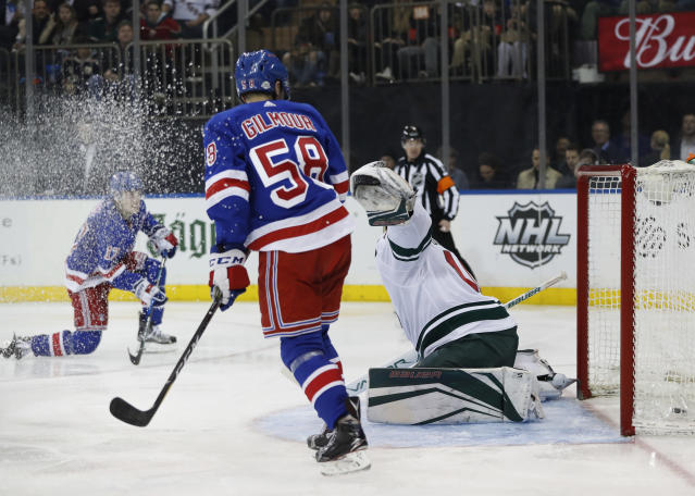New York Rangers John Gilmour (58) watches the puck go in as right wing Jesper Fast (17), of Sweden, scores on Minnesota Wild goaltender Devan Dubnyk, right, during the second period of an NHL hockey game in New York, Friday, Feb. 23, 2018. (AP Photo/Kathy Willens)