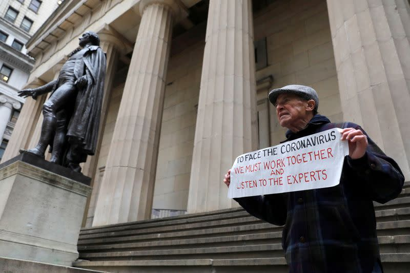 Bill Johnsen of Staten Island, 71, stands on the steps of Federal Hall on Wall Street, after more cases of coronavirus were confirmed in Manhattan, New York City