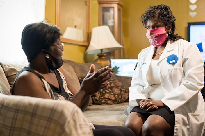 Dr. Karen Smith visits the home of Bessie Bratcher, 69, in Raeford, N.C., to administer Ms. Bratcher a Covid-19 vaccination. (Justin Kase Conder / for NBC News)