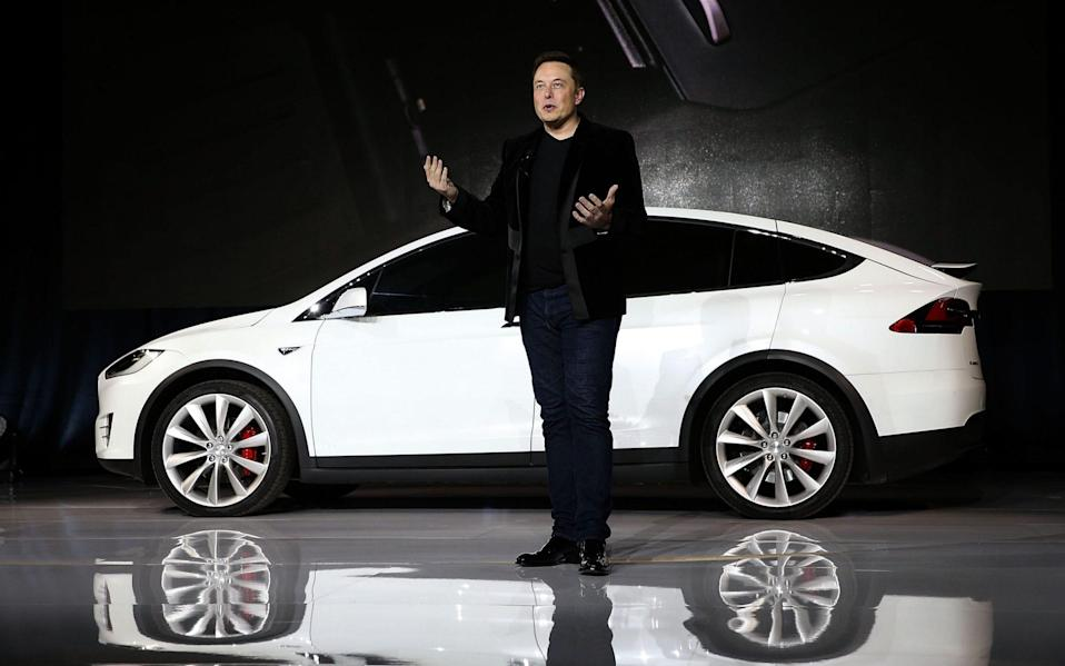 Tesla CEO Elon Musk speaks during an event to launch the new Tesla Model X Crossover SUV - Justin Sullivan /Getty Images North America