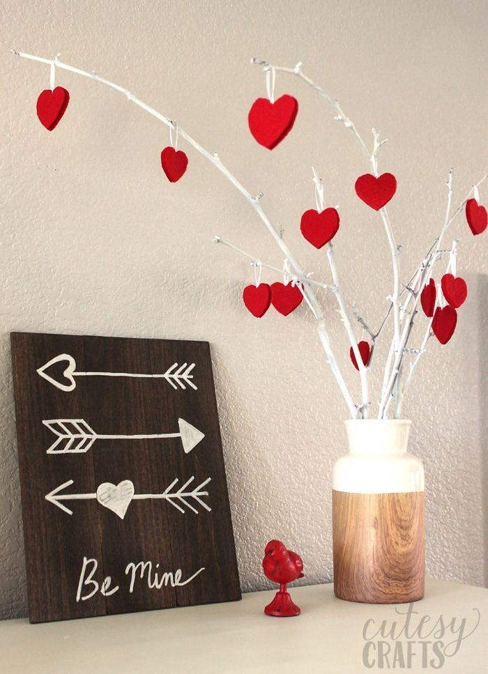 "<p>Use felt and ribbon to create an abundance of heart-shaped ornaments perfect for decorating your home or adding extra sweetness when tied into the ribbons on a wrapped gift.</p><p><em><a href=""https://cutesycrafts.com/2018/01/felt-heart-valentine-ornaments.html"" rel=""nofollow noopener"" target=""_blank"" data-ylk=""slk:Get the how-to at Cutesy Crafts»"" class=""link rapid-noclick-resp"">Get the how-to at Cutesy Crafts»</a></em><br></p><p><strong>RELATED</strong>: <a href=""https://www.goodhousekeeping.com/holidays/valentines-day-ideas/a25952395/valentines-day-captions/"" rel=""nofollow noopener"" target=""_blank"" data-ylk=""slk:55 Cutest Valentine's Day Caption Ideas for All of Your Sweet Photos"" class=""link rapid-noclick-resp"">55 Cutest Valentine's Day Caption Ideas for All of Your Sweet Photos</a><br></p>"