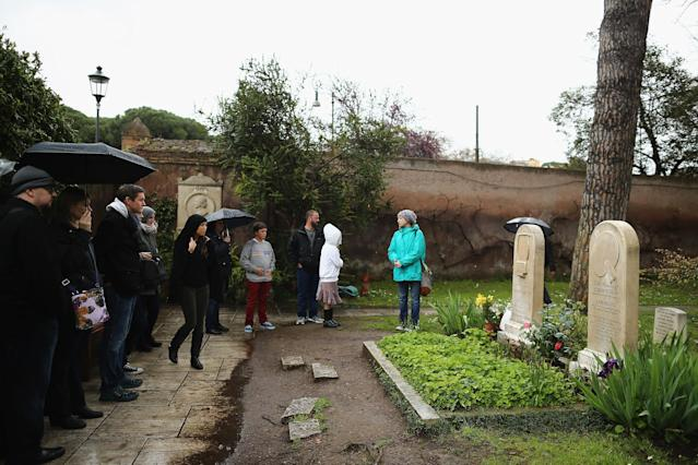 ROME, ITALY - MARCH 26: Visitors arrive to looks at the gravestones of poet John Keats, (1795-1821), (L) and painter and friend Joseph Severn, (1803-79) (R) which lie in Rome's 'Non Catholic Cemetery' on March 26, 2013 in Rome, Italy. John Keats, one of England's most famous poets died early in 1820 of tuberculosis aged 25, after travelling to Italy in search of a better climate to help cure him of the disease. Rome's Non-Catholic Cemetery contains one of the highest densities of famous and important graves anywhere in the world. It is the final resting-place of the poets Percy Shelley and John Keats, as well as many other painters, sculptors and authors who died in Rome. The cemetery which began it's use in 1730 continues today, containing graves of Orthodox Christians, Jews, Muslims and other non-Christians, and is one of the oldest burial grounds in Europe. (Photo by Dan Kitwood/Getty Images)