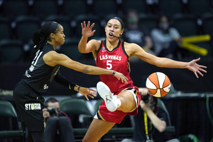 Las Vegas Aces' Dearica Hamby (5) defends against Seattle Storm's Jordin Canada in the first half of a WNBA basketball game Saturday, May 15, 2021, in Everett, Wash. (AP Photo/Elaine Thompson)