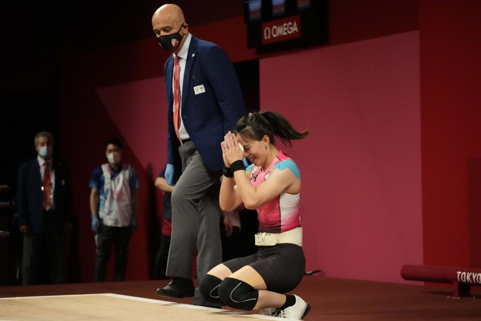 Kuo Hsing-Chun of Taiwan celebrates after winning the gold medal in the women's 59kg weightlifting event, at the 2020 Summer Olympics, Tuesday, July 27, 2021, in Tokyo, Japan. She won gold medal and sets a new Olympic record. (AP Photo/Luca Bruno)