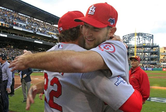 St. Louis Cardinals pitcher Michael Wacha, right, gets a hug from manager Mike Matheny after a 2-1 win over the Pittsburgh Pirates in Game 4 of a National League division baseball series on Monday, Oct. 7, 2013 in Pittsburgh. (AP Photo/Gene J. Puskar)