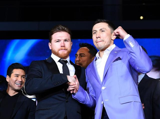 Boxers Canelo Alvarez (L) and Gennady Golovkin pose during a news conference at Microsoft Theater at L.A. Live, in February 2018 (AFP Photo/KEVORK DJANSEZIAN)
