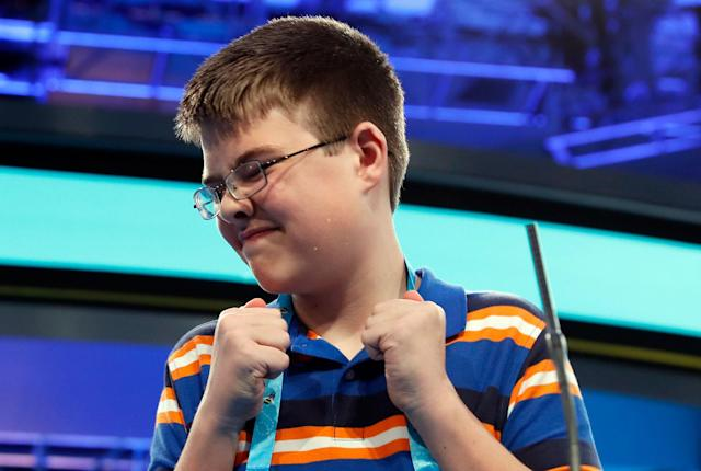 <p>Joel Miles, 14, from Greenwood, Mo., reacts after spelling his word correctly in the third round of the 90th Scripps National Spelling Bee, Wednesday, May 31, 2017, in Oxon Hill, Md. (AP Photo/Alex Brandon) </p>