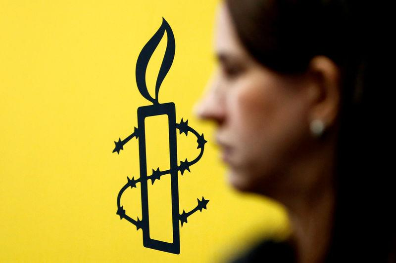 FILE PHOTO: The logo of Amnesty International is seen next to director of Mujeres En Linea Luisa Kislinger, during a news conference to announce the results of an investigation into humans rights abuses committed in Venezuela during protests against President Nicolas Maduro in Caracas, Venezuela February 20, 2019. REUTERS/Carlos Jass