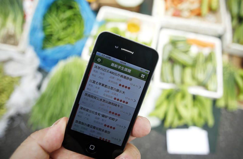 """A iPhone application """"China Survival Guide"""" that has a searchable database of food problems and updates daily, is shown Friday June 15, 2012 in Shanghai, China. The application and other tech tools underscore the deep anger in China over the country's persistent food safety problems and a new willingness among ordinary people to take the matter into their own hands. (AP Photo/Eugene Hoshiko)"""