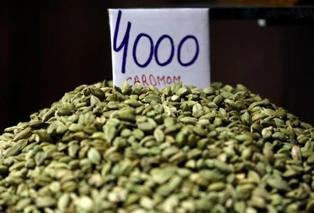 A price tag is seen on a sample of cardamom on display for sale in a market area in the old quarters of Delhi