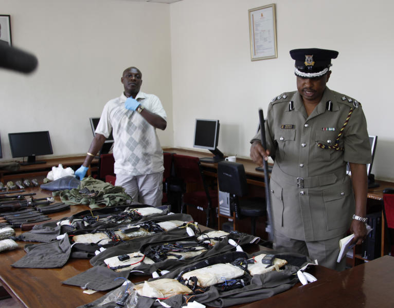 Kenya Police spokesman View Eric Kimathi displays siezed arms and ammunition to journalists in Nairobi, Kenya, Friday, Sep. 14, 2012. Kenyan police say they have arrested two people suspected to have links with an al-Qaida-linked Somali militant group that was in the last stages of planning a major terrorist attack. Boniface Mwaniki , the head of Kenya's Anti-Terrorism Police Unit, said Friday that police found four suicide vests, a cache of weapons and 12 grenades. Al-Shabab has vowed to carry out terror attacks in Kenya in retaliation against the country for sending troops into Somalia. (AP Photo/Khalil Senosi)
