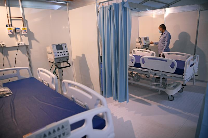 A technician works in the wards of the Riocentro field hospital which was set up to receive COVID-19 coronavirus patients, in Rio de Janeiro, Brazil, on April 29, 2020. - The field hospital has a capacity of 500 beds. Riocentro is a large exhibition and convention centre and was used as a venue during the 2016 Summer Olympic Games. (Photo by Carl DE SOUZA / AFP) (Photo by CARL DE SOUZA/AFP via Getty Images)