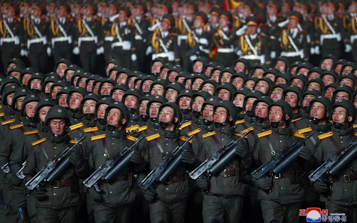 Thousands of troops marched alongside the weapons, none of them wearing masks - KCNA/Reuters