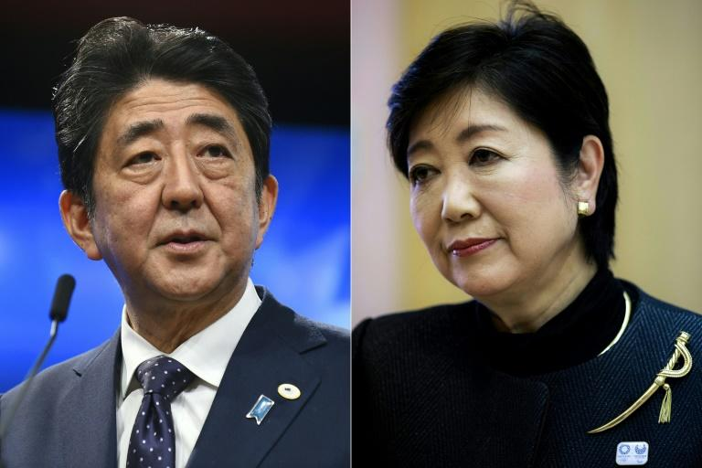 Japan's Prime Minister Shinzo Abe (L) is poised for a comfortable victory over Yuriko Koike