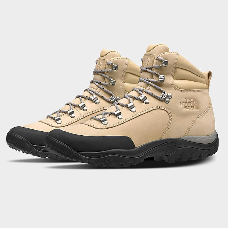 """Unruly elements are no match for The North Face's all-terrain boots. Whether you're logging miles through wet or snowy conditions, this stonewash pair will keep your feet toasty and comfy. Peep the rubber sole covering the toes to keep them extra warm and dry. $200, The North Face. <a href=""""https://www.thenorthface.com/shop/womens-archive-glacier-point-boot-nf0a4o9f"""" rel=""""nofollow noopener"""" target=""""_blank"""" data-ylk=""""slk:Get it now!"""" class=""""link rapid-noclick-resp"""">Get it now!</a>"""