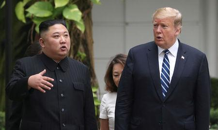 FILE PHOTO: North Korea's leader Kim Jong Un and U.S. President Donald Trump talk in the garden of the Metropole hotel during the second North Korea-U.S. summit in Hanoi, Vietnam February 28, 2019. REUTERS/Leah Millis/File Photo