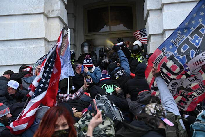 Trump supporters clash with police and security forces as they storm the US Capitol in Washington, DC on January 6, 2021. (Brendan Smialowski/AFP via Getty Images)