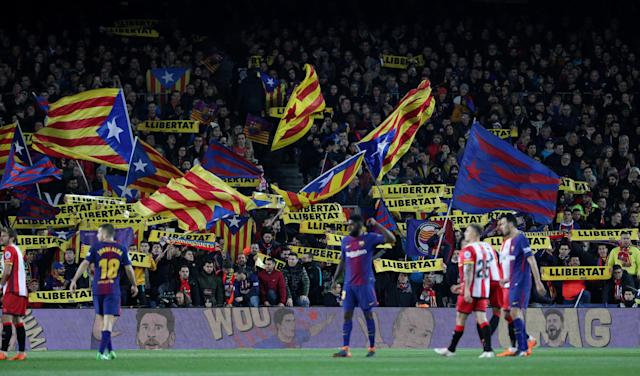 "Soccer Football - La Liga Santander - FC Barcelona vs Girona - Camp Nou, Barcelona, Spain - February 24, 2018 General view of fans waving Catalan flags and holding up ""Llibertat"" banners during the match REUTERS/Sergio Perez"