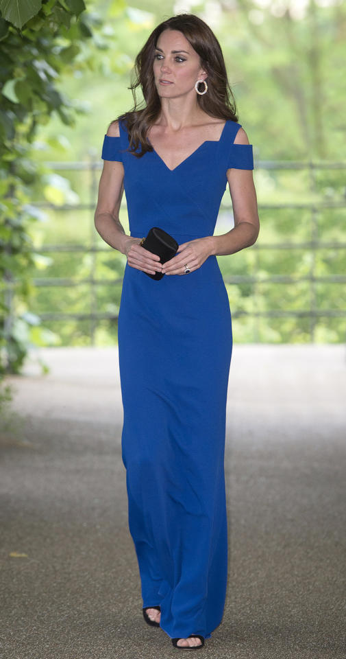 <p>Princess Kate gave the cold shoulder at a SportsAid dinner in a royal blue Roland Mouret gown. <i>(Picture by Eddie Mulholland/WPA-Pool)</i><br /></p>