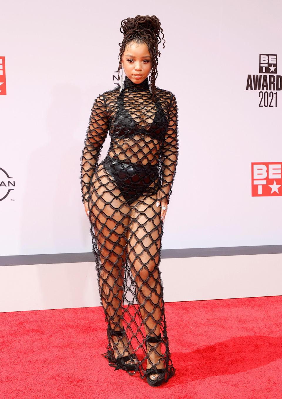 One half of Chloe x Halle, Chloe Bailey went solo but turned up the temperature times two on the red carpet when she turned up in a sheer mesh gown from Valentino.