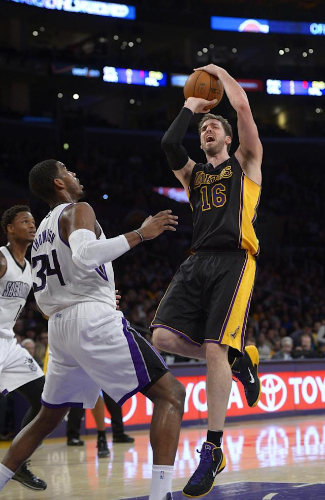 Los Angeles Lakers center Pau Gasol, of Spain,, right, puts up a shot as Sacramento Kings forward Jason Thompson defends during the first half of an NBA basketball game, Friday, Feb. 28, 2014, in Los Angeles. (AP Photo/Mark J. Terrill)