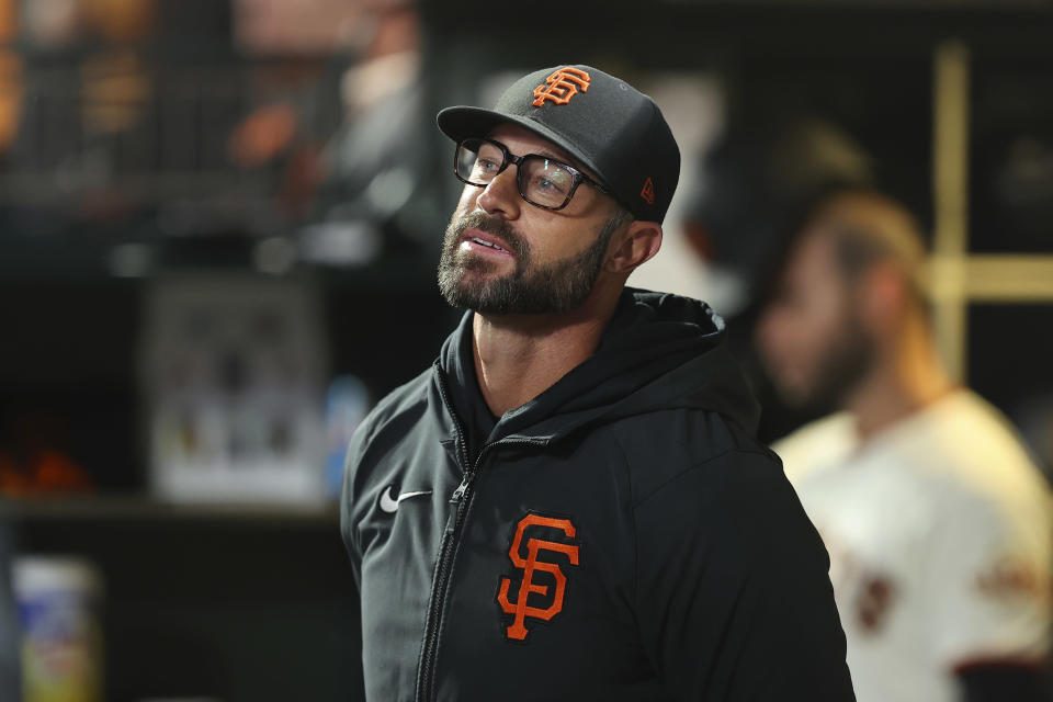 San Francisco Giants manager Gabe Kapler watches from the dugout during the fifth inning of Game 1 of his team's baseball National League Division Series against the Los Angeles Dodgers Friday, Oct. 8, 2021, in San Francisco. (AP Photo/John Hefti)
