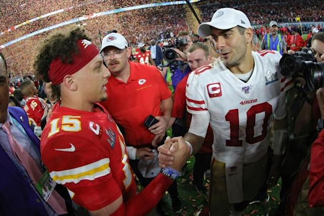 San Francisco 49ers quarterback Jimmy Garoppolo, right, shakes hands with Kansas City Chiefs Patrick Mahomes after Super Bowl LIV at Hard Rock Stadium in Miami, Florida. (AFP Photo/TOM PENNINGTON)