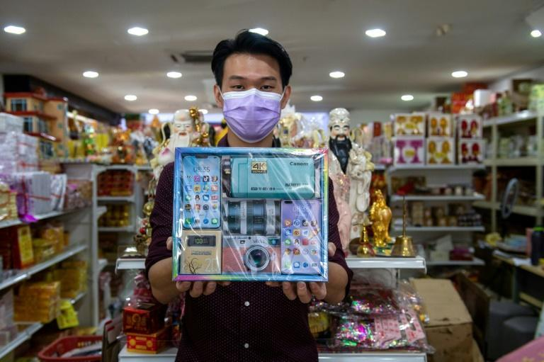 Jacky Hoi showcases some of his store's Qingming offerings