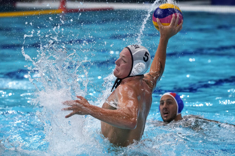 United States' Hannes Daube (5) shoots against Italy during a preliminary round men's water polo match at the 2020 Summer Olympics, Thursday, July 29, 2021, in Tokyo, Japan. (AP Photo/Mark Humphrey)