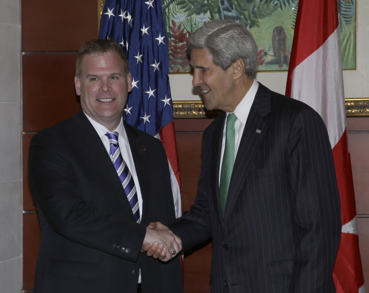 U.S. State Secretary John Kerry, right, greets Canadian Foreign Minister John Baird prior to their bilateral meeting on the sideline of the Asia-Pacific Economic Cooperation (APEC) ministerial meeting in Nusa Dua, Bali, Indonesia, Saturday, Oct. 5, 2013. (AP Photo/Dita Alangkara)