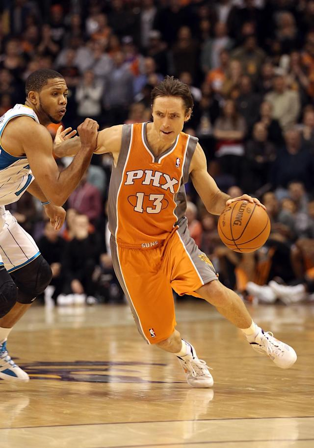 PHOENIX, AZ - DECEMBER 26: Steve Nash #13 of the Phoenix Suns handles the ball against the New Orleans Hornets during the season openning NBA game at US Airways Center on December 26, 2011 in Phoenix, Arizona. The Hornets defeated the Suns 85-84. NOTE TO USER: User expressly acknowledges and agrees that, by downloading and or using this photograph, User is consenting to the terms and conditions of the Getty Images License Agreement. (Photo by Christian Petersen/Getty Images)