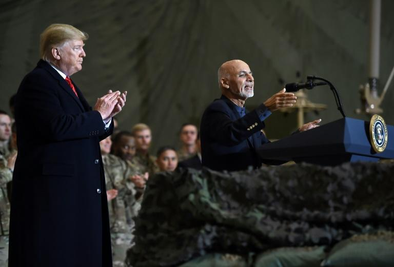 Afghan's President Ashraf Ghani speaks to the troops as US President Donald Trump listens (AFP Photo/Olivier Douliery)
