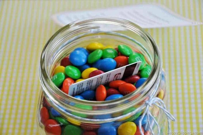 """<p>This is the gift that keeps on giving … twice. Not only will people be delighted to receive a jar of candy, but then when they open the lid and realize there's more to this """"cookie jar"""" than meets the eye, you'll have achieved a gift-giving double whammy. <i>(Photo: <a href=""""http://www.happyclippings.com/2012/05/teacher-gift-youre-my-mm-poem-jar-plus-other-ideas.html"""" rel=""""nofollow noopener"""" target=""""_blank"""" data-ylk=""""slk:Happy Clippings"""" class=""""link rapid-noclick-resp"""">Happy Clippings</a>)</i></p>"""