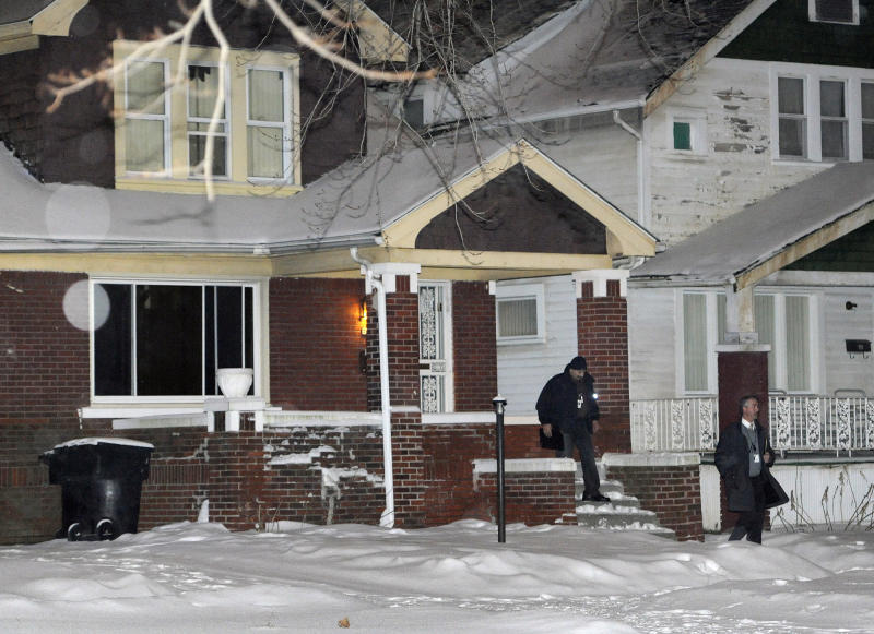 A Detroit Police Officer and an investigator exit a home, just four houses away from where a four year old boy was shot with a rifle on Thursday, Jan. 16, 2014 in Detroit. A 4-year-old girl accidentally shot her 4-year-old cousin to death with a loaded rifle that she found under a bed at their grandfather's Detroit home, police said Friday. The girl was playing and watching TV on Thursday afternoon with the 4-year-old boy and his 5-year-old sister when she found the gun, police Sgt. Michael Woody said. He said she picked up the weapon, pointed it at the boy and shot him once in the chest. (AP Photo/Detroit News, Jose Juarez) DETROIT FREE PRESS OUT; HUFFINGTON POST OUT