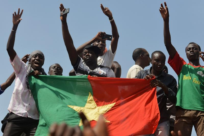 People celebrate after embattled President Blaise Compaore announced that he was stepping down in Ouagadougou on October 31, 2014 (AFP Photo/Issouf Sanogo)