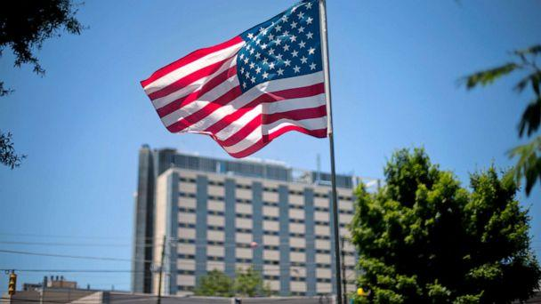 PHOTO: An American flag flies in front of the Atlanta VA Medical Center in Atlanta, May 24, 2013. (David Goldman/AP, FILE)