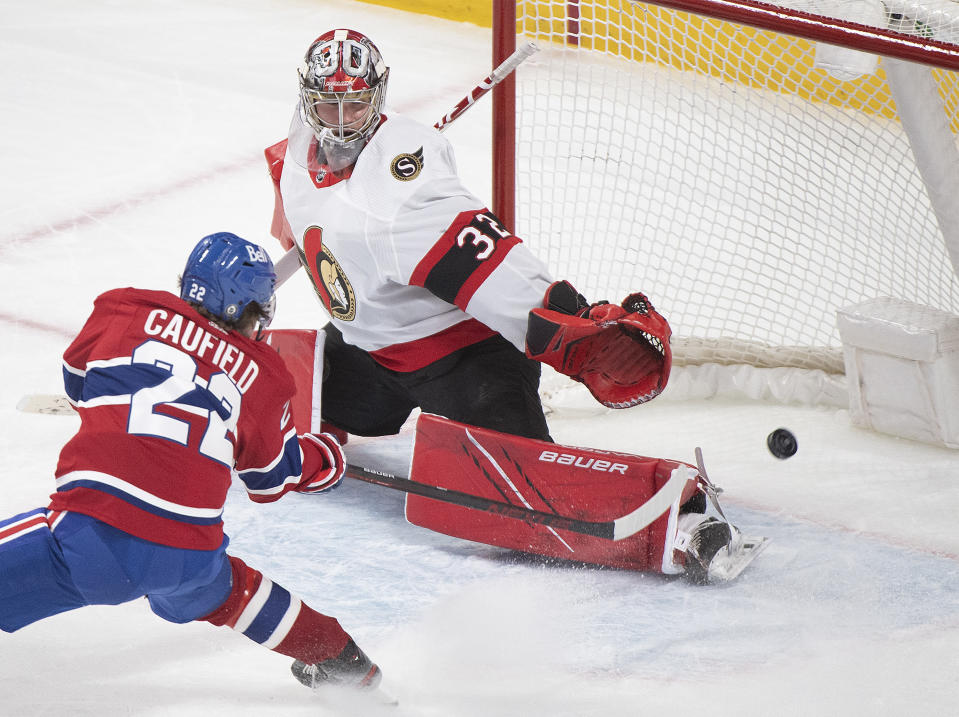 FILE - In this May 1, 2021, file photo, Montreal Canadiens' Cole Caufield scores against Ottawa Senators' goaltender Filip Gustavsson during overtime of an NHL hockey game in Montreal. Caufield was dominating college hockey in late March and by late May was a regular in the lineup of the most storied franchise in the NHL, helping the Canadiens advance to the third round of the playoffs. (Graham Hughes/The Canadian Press via AP, iIle)