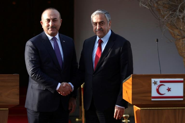 Turkish Cypriot leader Mustafa Akinci (right) holds a press conference with Turkish Foreign Minister Mevlut Cavusoglu after a meeting in the self-proclaimed Turkish Republic of Northern Cyprus (TRNC) on February 21, 2017