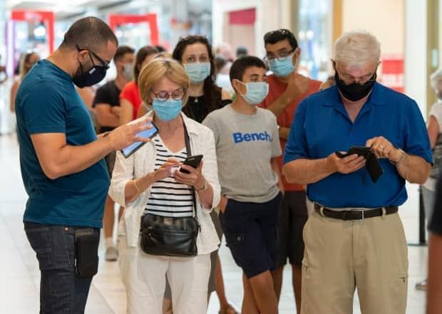 The Saskatchewan Health Authority will require families and visitors to properly wear medical masks at all times within health-care facilities and long-term care homes.  (Ryan Remiorz/The Canadian Press - image credit)