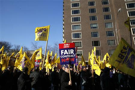 Members of the Service Employees International Union (SEIU) march during a protest in support of a new contract for apartment building workers in New York City, April 2, 2014. REUTERS/Mike Segar